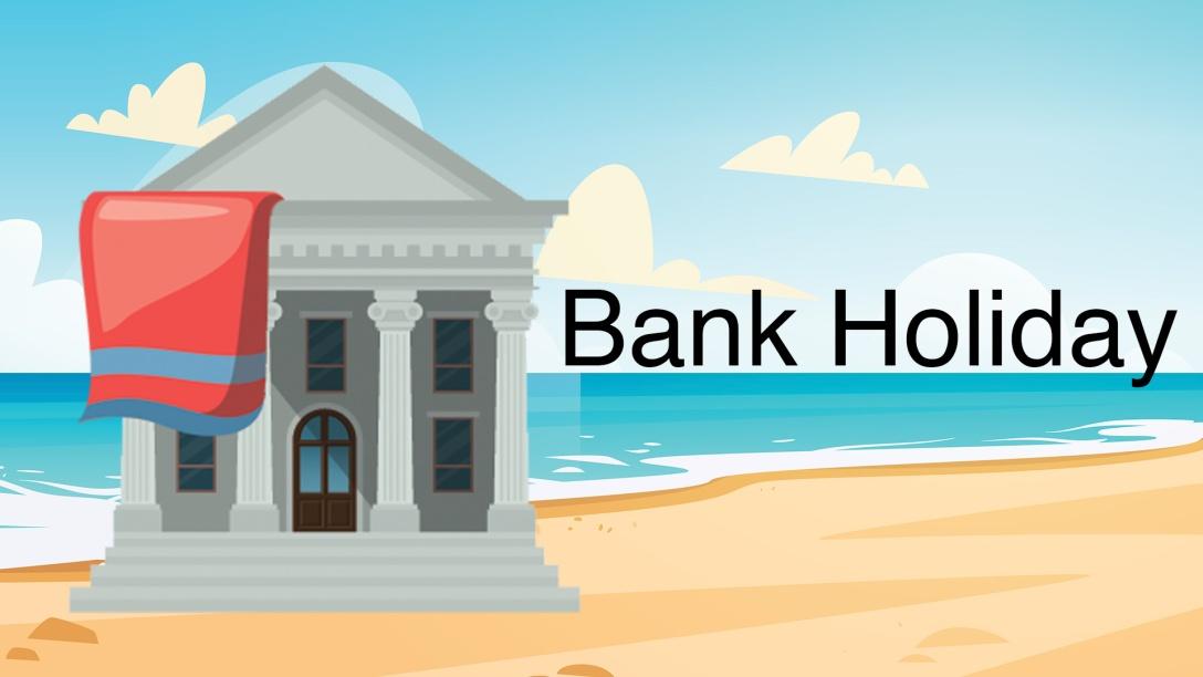 A bank on the beach with a beach towel.